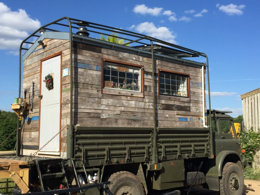 green army truck with wooden cladding