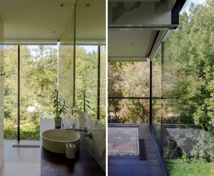 bathroom with soaking tub and all-glass walls