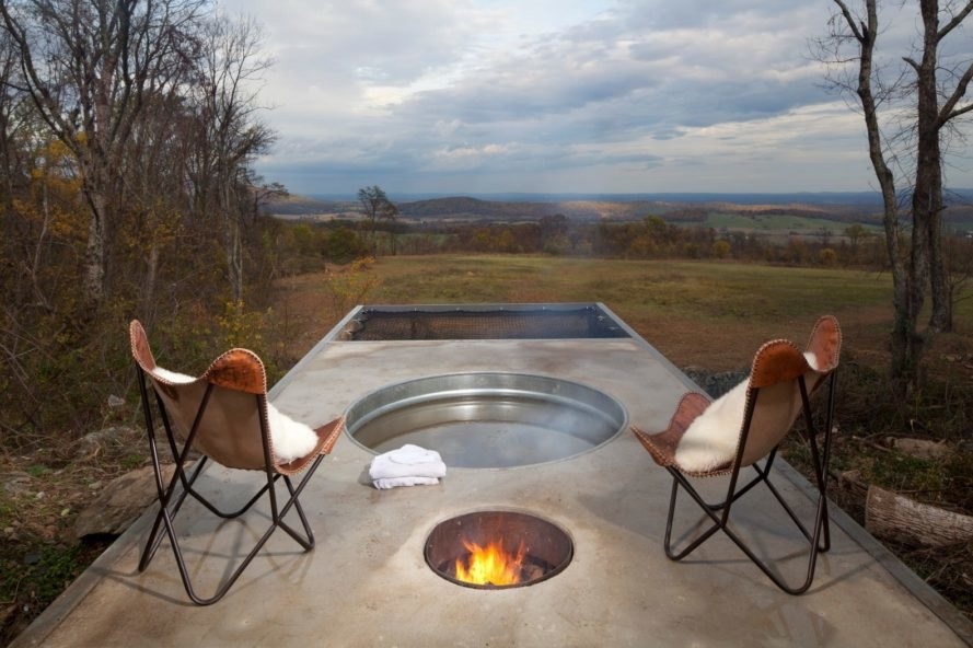 two chairs and a metal hot tub