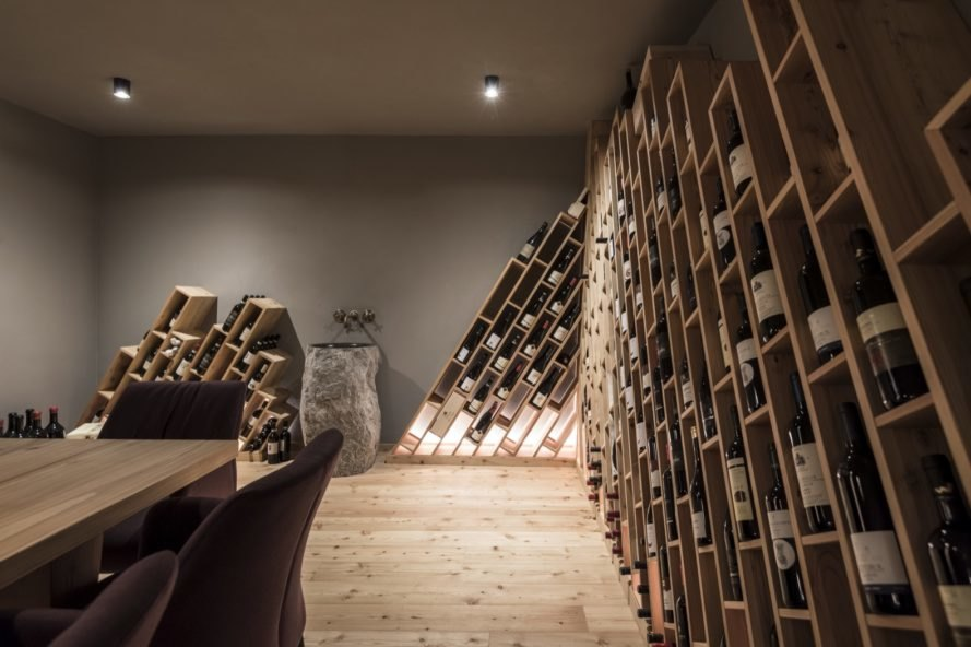 hotel wine cellar with intricate modern design storing individual bottles