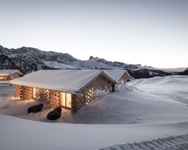 snow covered chalet in mountains