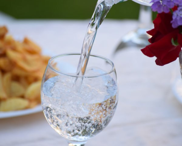 mineral water poured into a glass