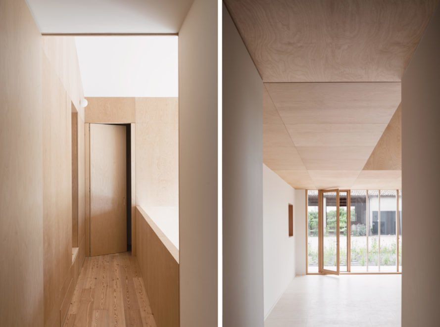white and light wood-lined rooms