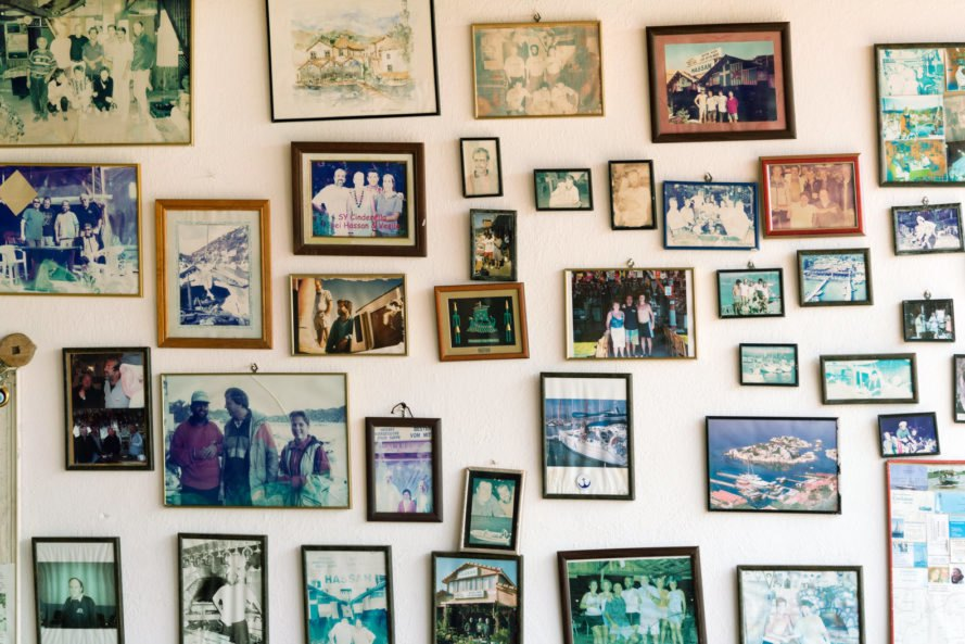 varied framed photos on a white wall