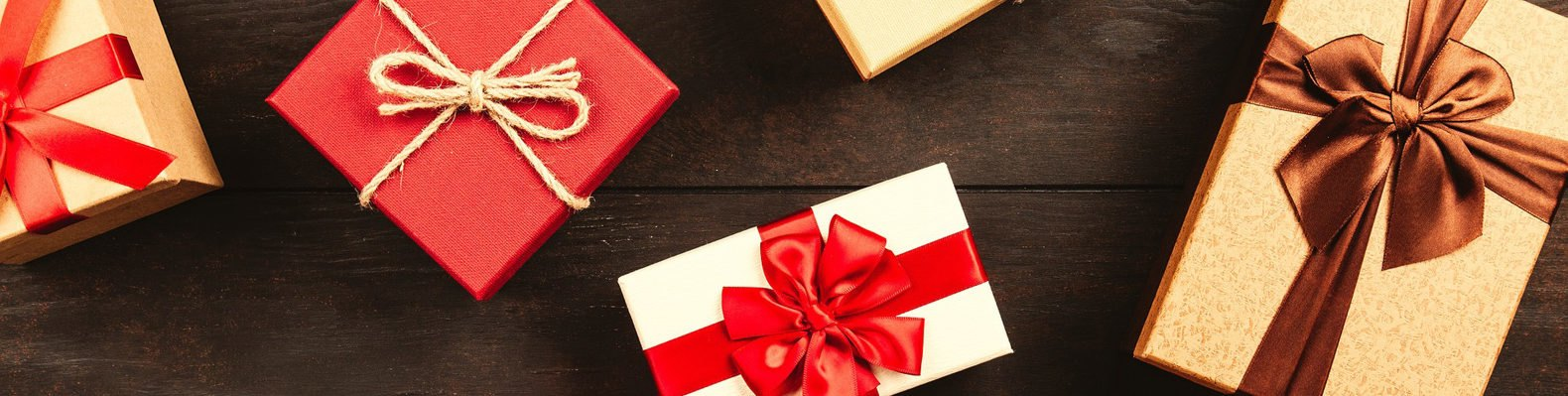 red and white present boxes on wood background