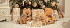 presents and teddy bears under a Christmas tree
