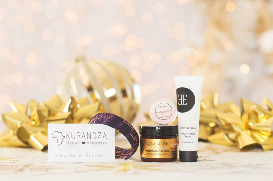 handmade bracelet and skincare with lights and holiday decor in background