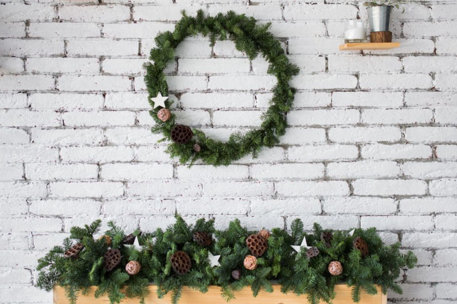 wood mantle with evergreen garland