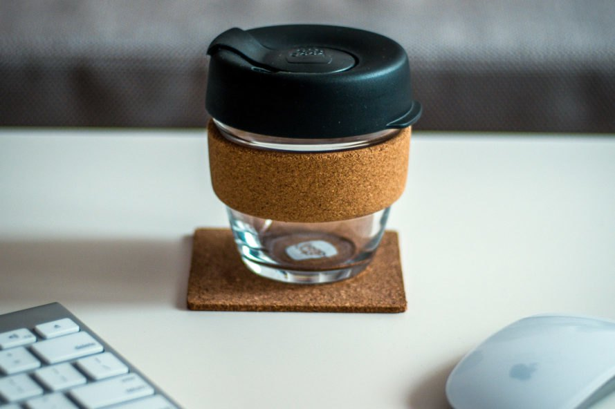 glass coffee cup with cork sleeve