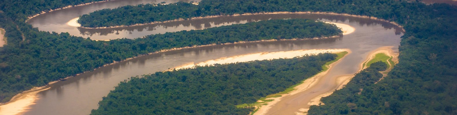 Nanay River in the Peruvian Amazon surrounded by greenery