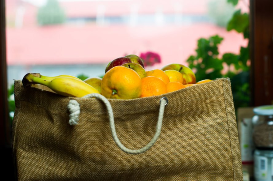 reusable grocery bag filled with fruits