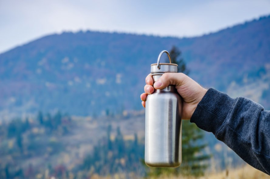 hand holding refillable stainless steel water container