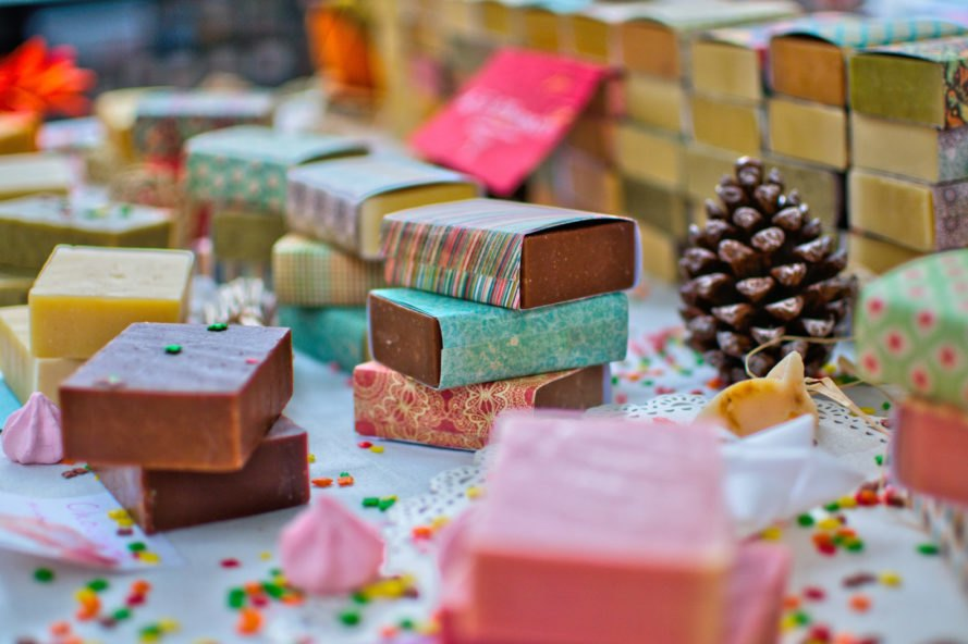 table full of colorful handmade bar soaps