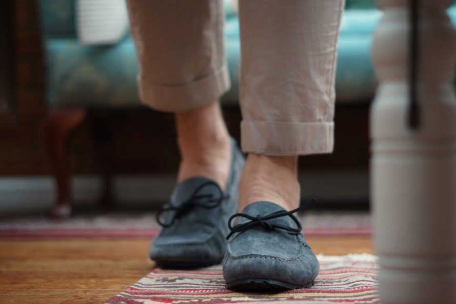 man wearing gray loafers