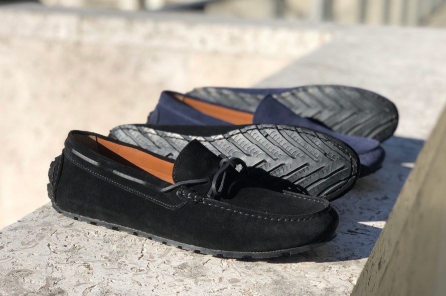 black and navy loafers on a stone ledge