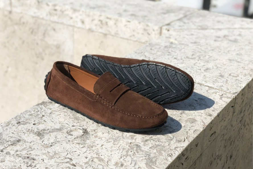 brown loafers on a stone ledge