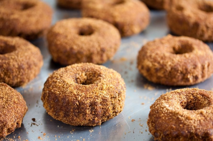 cinnamon donuts on a baking sheet