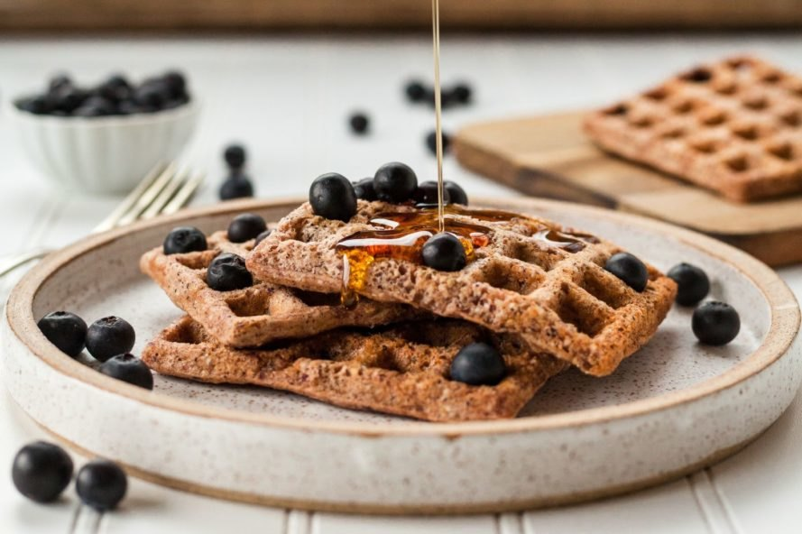 wheat waffles with blueberries and maple syrup