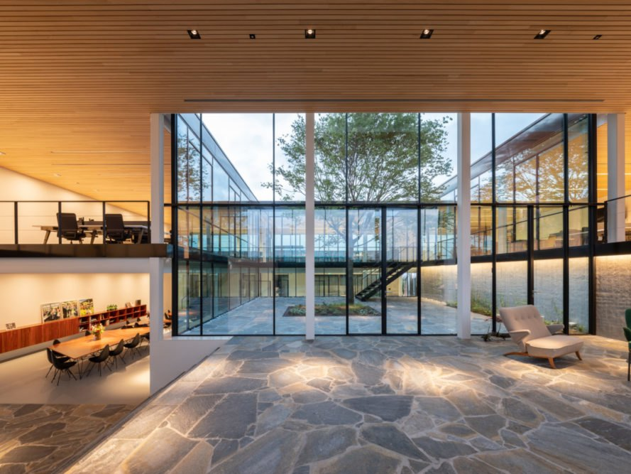 interior office space with natural stone flooring and glass walls