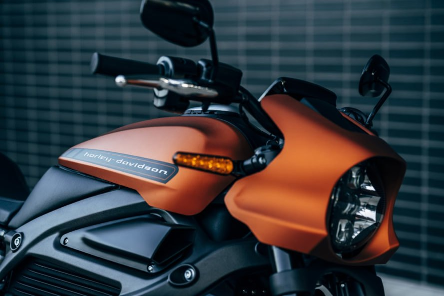 black and orange electric motorcycle