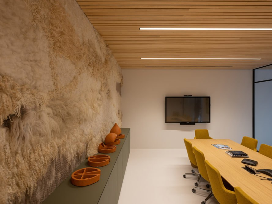 boardroom with felt wall and large table with chairs