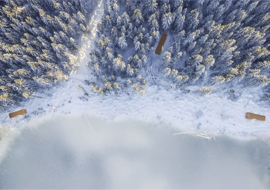 aerial rendering of long rectangular cabins in snow-covered forest