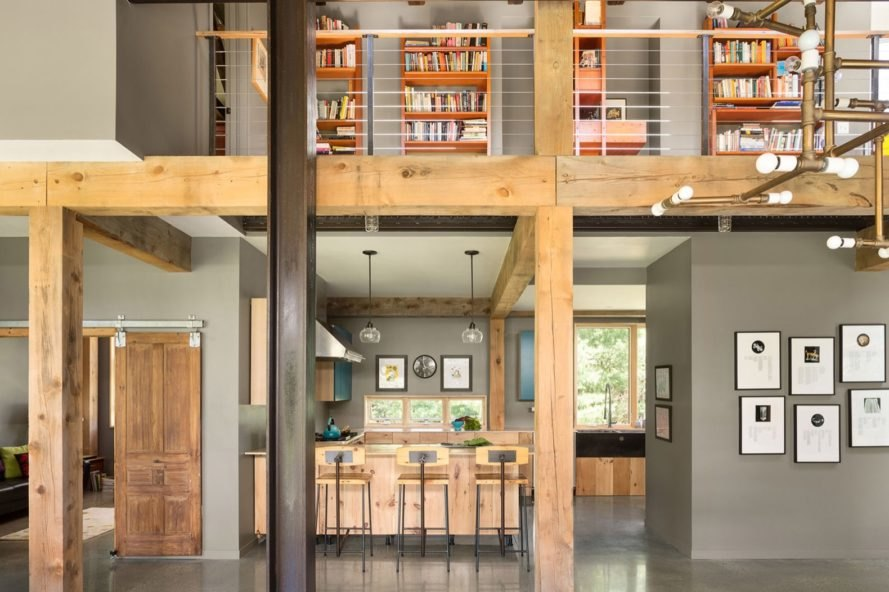 gray room with wood beams