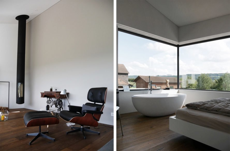 On the left, leather seat in white room. On the right, bed facing a free-standing tub.
