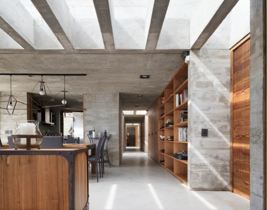 interior living space with concrete walls and flooring