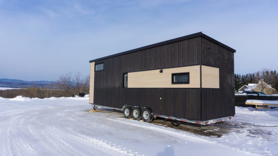 two-tone tiny home on wheels