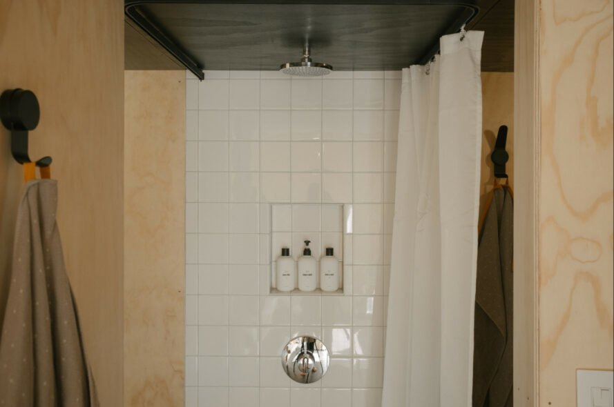 white tiled shower stall