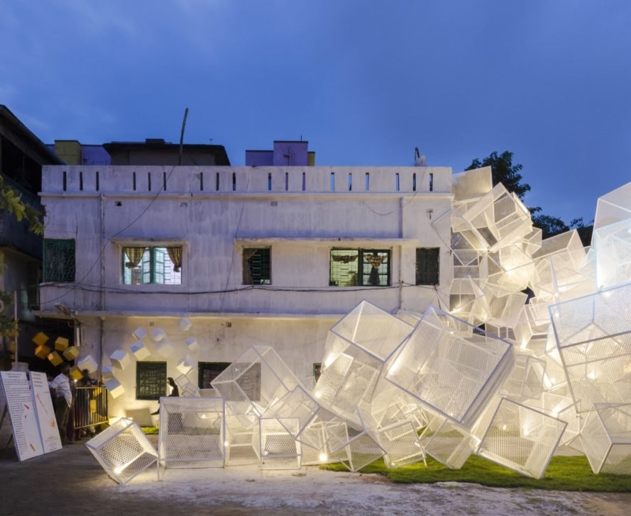 white mesh cube structures lit up at night