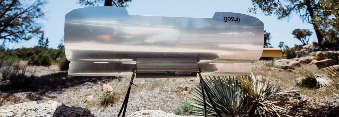 solar cooker on a rocky landscape