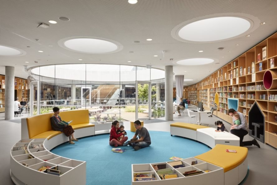 library with circular benches and wall of books