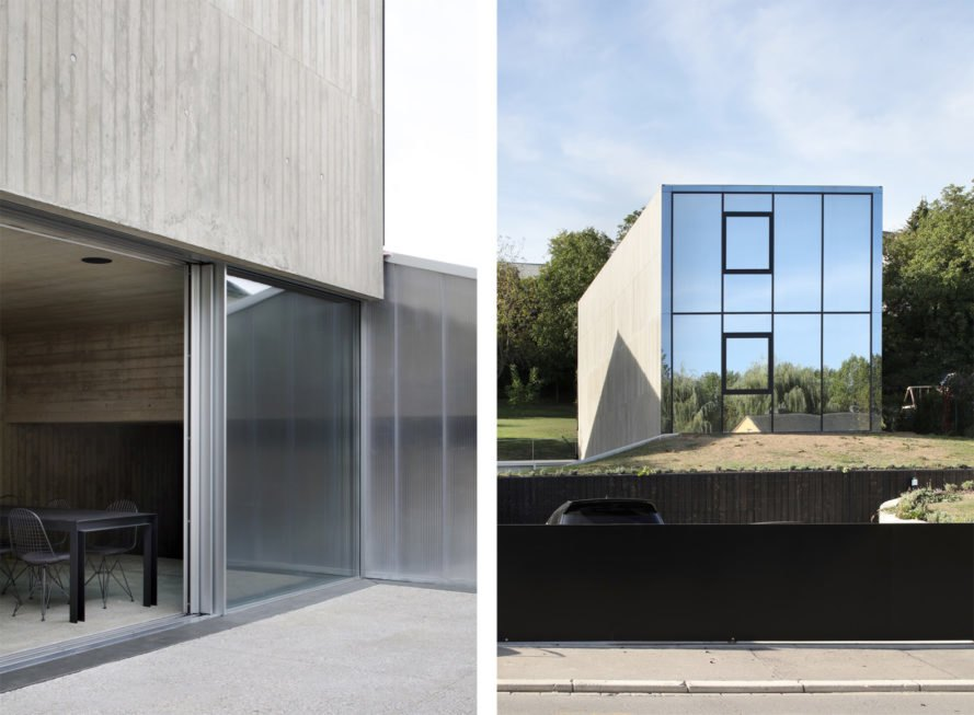 On the left, glass door opening onto a patio. On the right, gray home with mirrored wall.