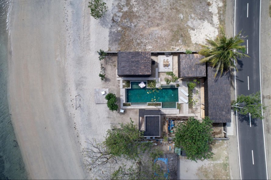 aerial image of a beachside resort with pool