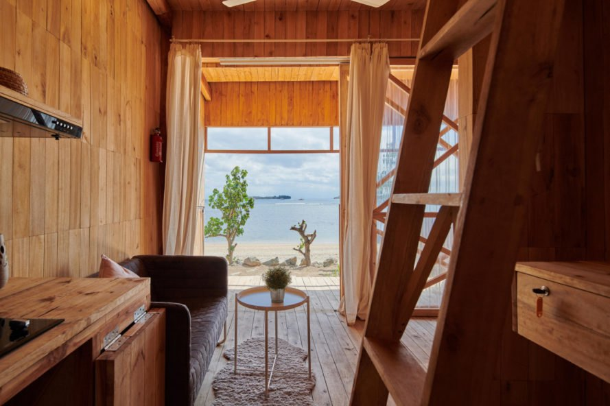 room with a large open view of the beach