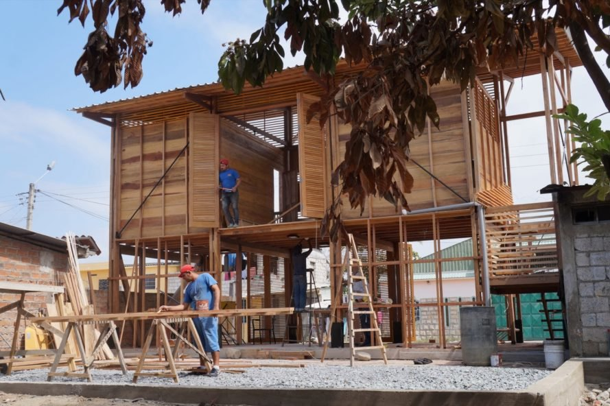 people constructing a wood structure