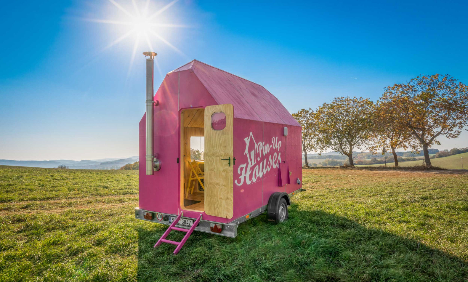 An itty-bitty tiny home on wheels is pretty in pink
