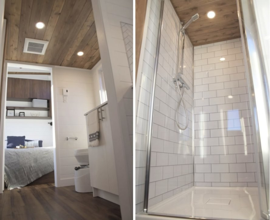 bathroom and shower stall with subway tiles