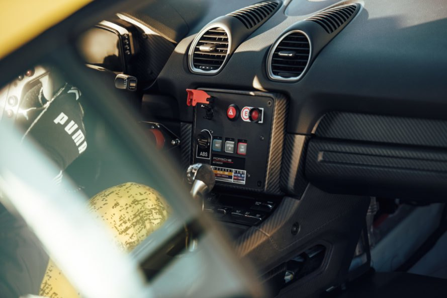 interior view of porsche cayman with driver's coclpit