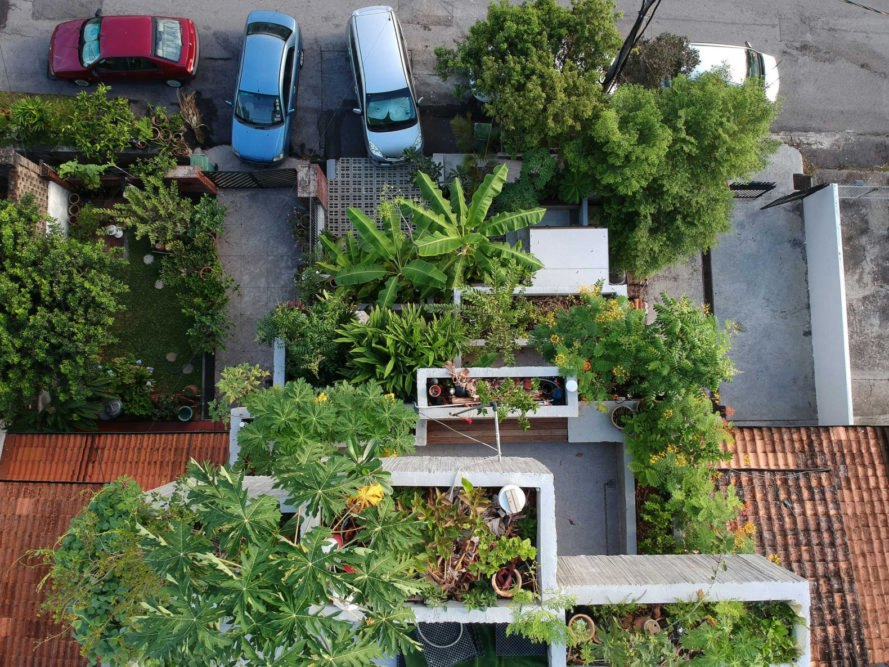 aerial shot of concrete home with greenery on multiple levels