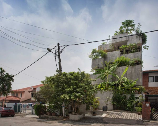 concrete home with greenery on multiple levels