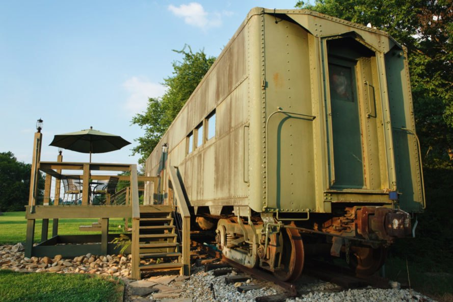 angled shot of old train car clad in wood