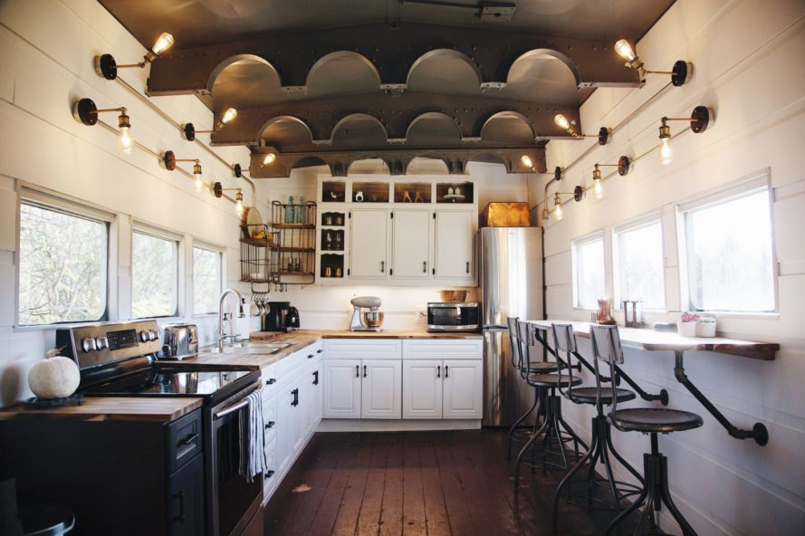 large kitchen space with white cabinets and dark wood floors