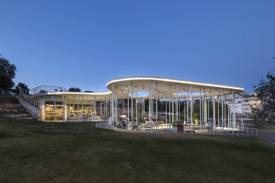 cafe with white pillars and roof in park