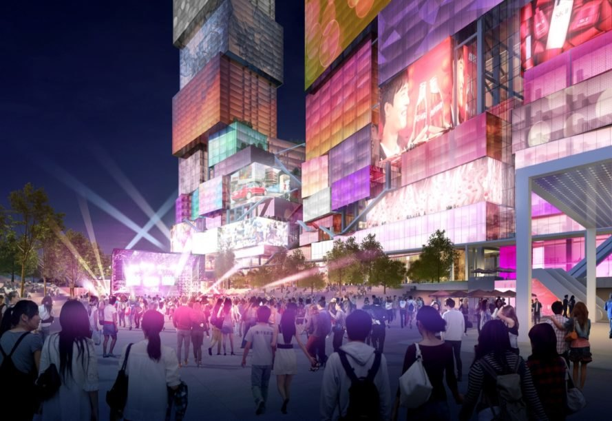 rendering of people standing looking up at towers covered in media screens on towers