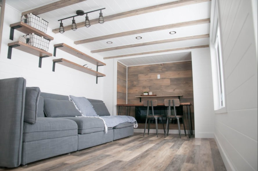 tiny home living space with grey sofa
