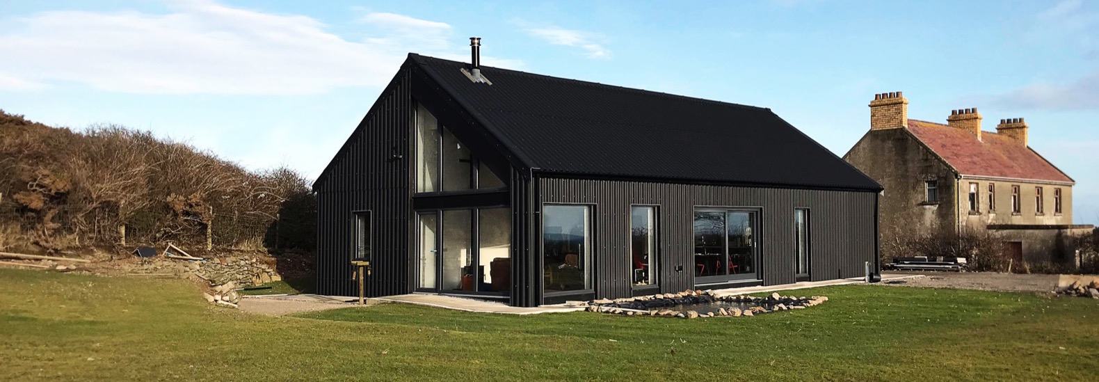 Metal clad eco cottage puts a modern spin on irish rural architecture