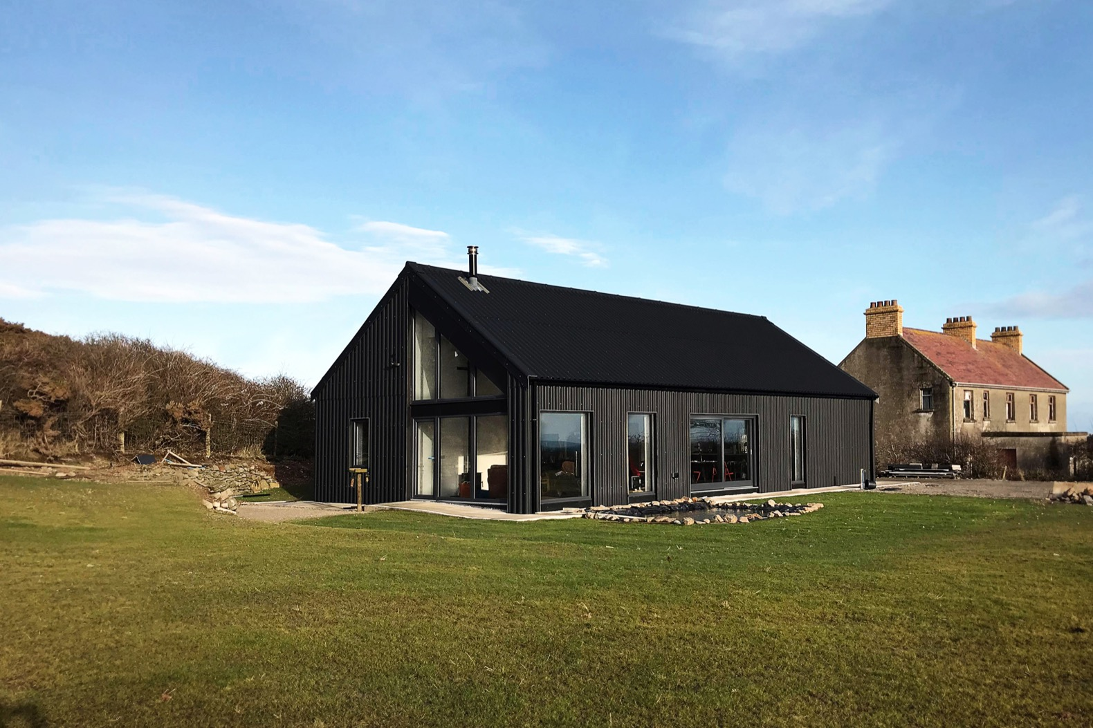 Metal-clad Eco Cottage puts a modern spin on Irish rural architecture
